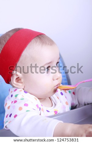 Baby eating lunch - stock photo