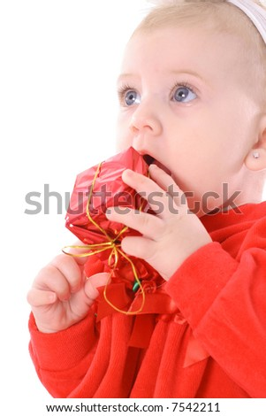 baby eating present - stock photo