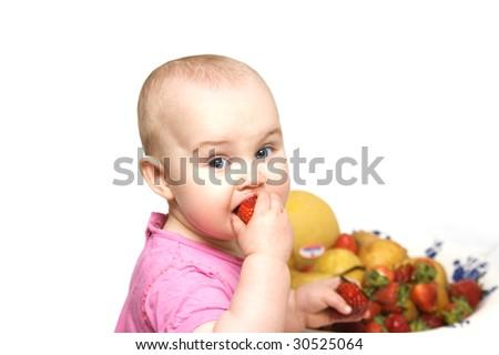 Baby eating strawberry - stock photo