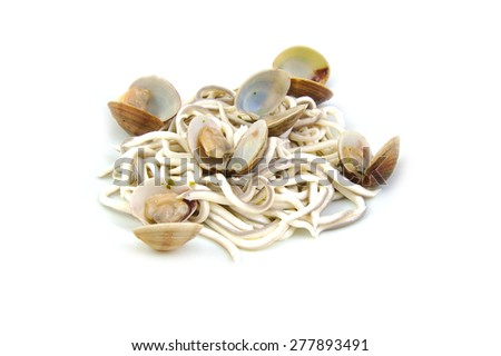 Baby eels, gulas or elver substitute with clams in garlic sauce. Traditional Spanish tapa.  - stock photo