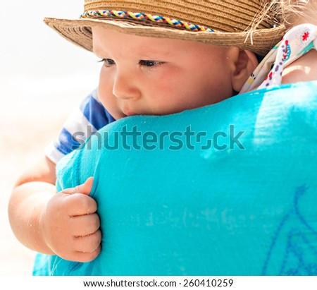 Baby embracing mother - stock photo