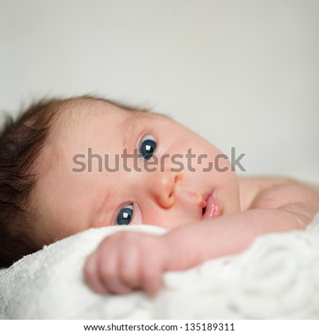 Baby, face close-up, cute newborn - stock photo
