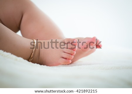 baby feet close up with  Anklet
