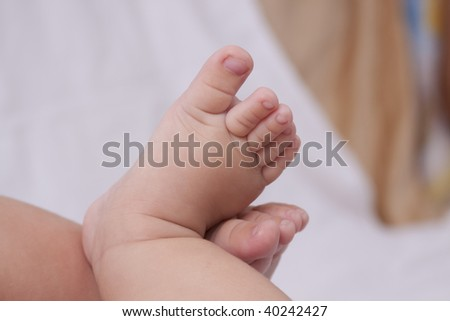 baby feet front view on white background - stock photo