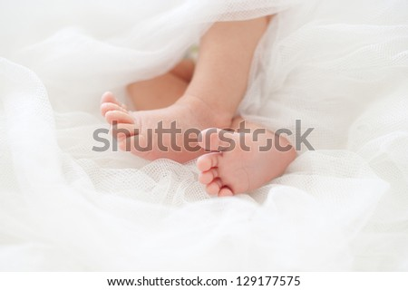 Baby feet in a white diaper