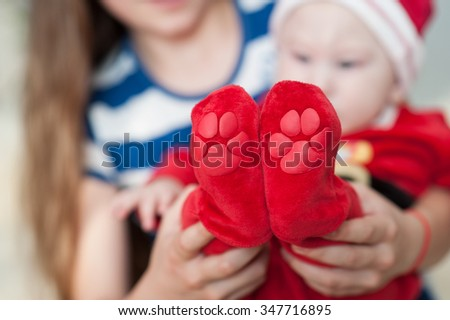 Baby feet in mother hands. Beautiful conceptual image of Maternity. - stock photo
