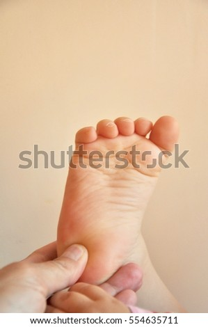 Baby feet in mothers hand
