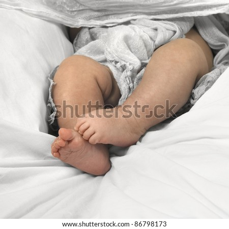 baby feet in textile ambiance