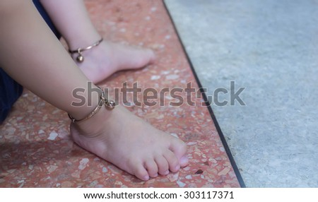 Baby Feet with  Anklets - stock photo