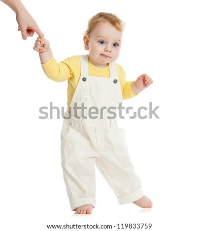 baby first steps keeping parent's finger - stock photo