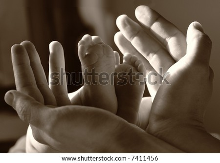 baby foot in father hand