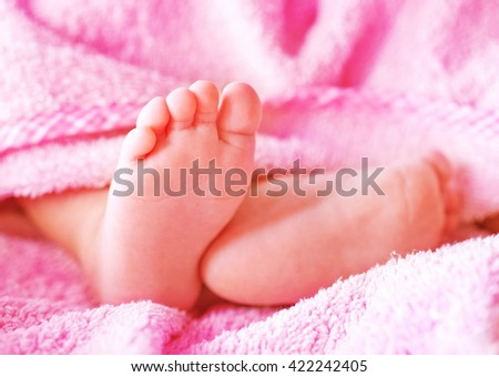 baby foot, newborn foot  on the bag - stock photo