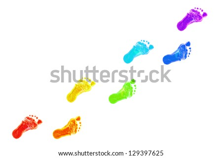 Baby foot prints all colors of the rainbow. The joyful journey. Isolated on white background - stock photo