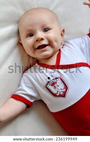 Baby football fan happy because of the goal - stock photo