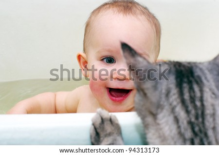 baby girl and cat - stock photo