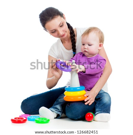 baby girl and mother playing together with toy - stock photo