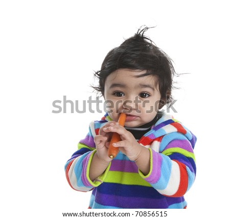 Baby Girl Attempting to Eat Carrot, Isolated, White - stock photo