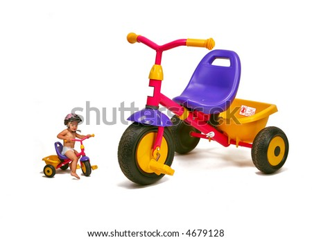 baby girl   - big and small bike - stock photo