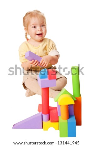 Baby girl building from toy blocks. Isolated on white background - stock photo