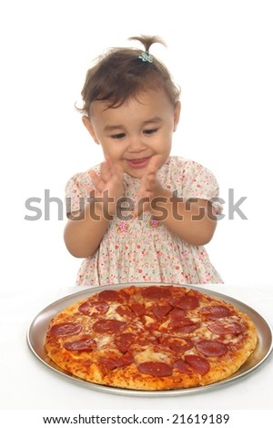 Baby girl clapping over pizza