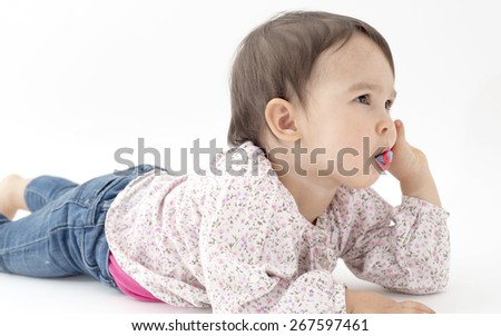 baby girl cleans teeth isolated on white - stock photo