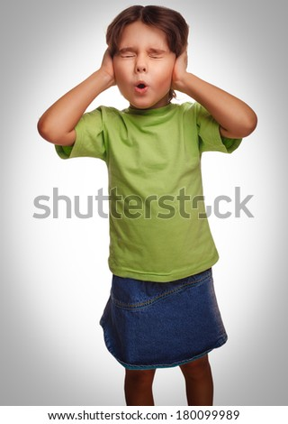 baby girl closed her eyes her ears loud fear noise isolated on white background gray - stock photo