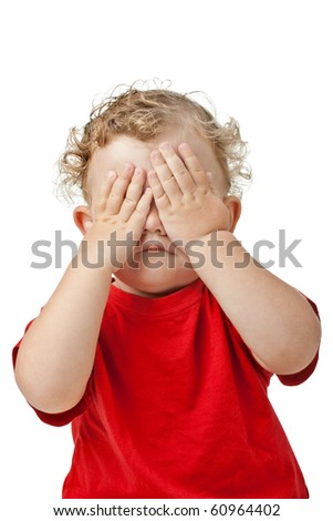 Baby girl covering her eyes with her hands playing peek-a-boo isolated on white - stock photo