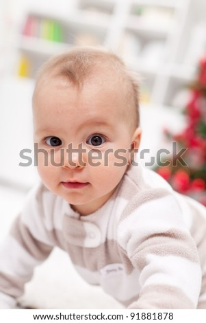 Baby girl crawling on the floor - closeup