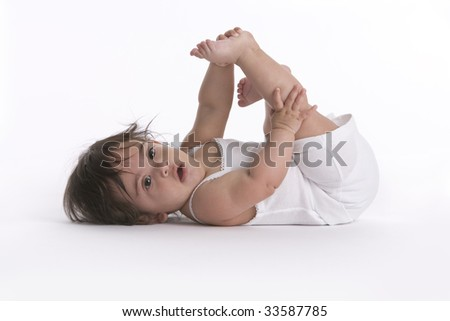 Baby girl doing stretch exercise - stock photo