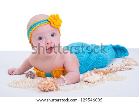 Baby girl dressed as a mermaid . Isolated on white background - stock photo