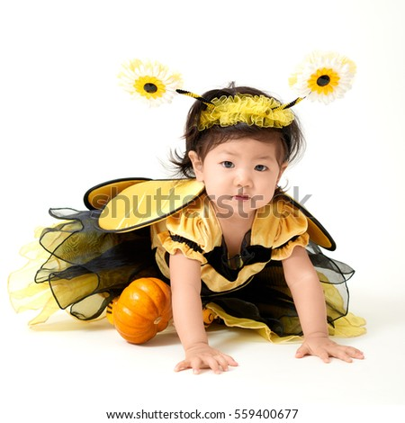Baby girl dressed as cute little bee with a small pumpkin smiling  sc 1 st  Shutterstock & Baby Girl Dressed Cute Little Bee Stock Photo (Safe to Use ...