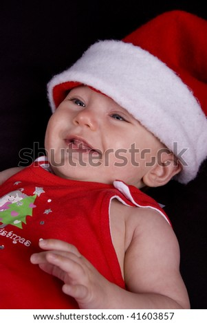 Baby girl dressed up in santa hat and red dress - stock photo
