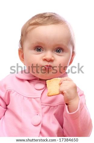 Baby girl  eating bread - stock photo