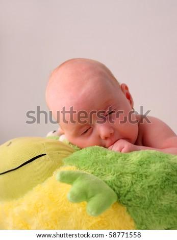 Baby girl falling asleep - stock photo