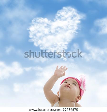 Baby girl hand towards sky - stock photo