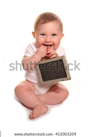 Baby girl holding blank chalkboard sign cutout - stock photo