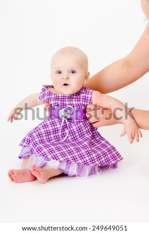 baby girl in a dress. studio photo
