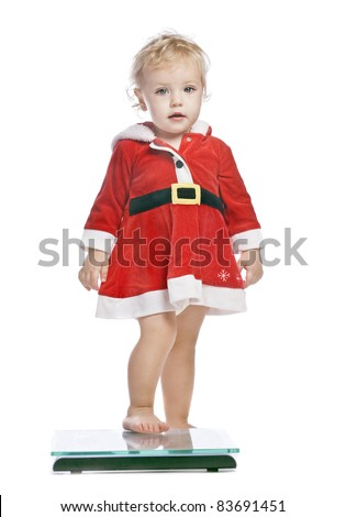 baby girl in a red christmas  fancy dress - stock photo