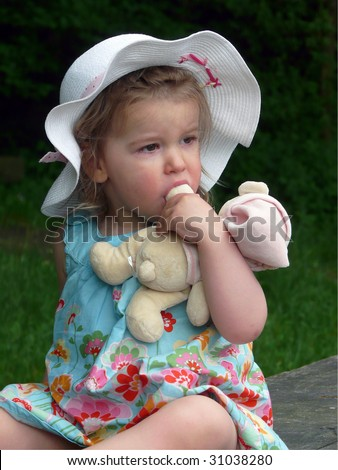 Baby girl in a straw-hat. - stock photo