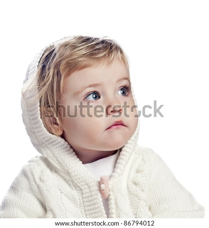 baby girl in a white cap - stock photo