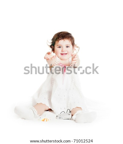 baby girl in a white dress - stock photo