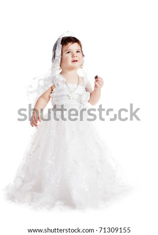 baby girl in a white wedding; dress - stock photo
