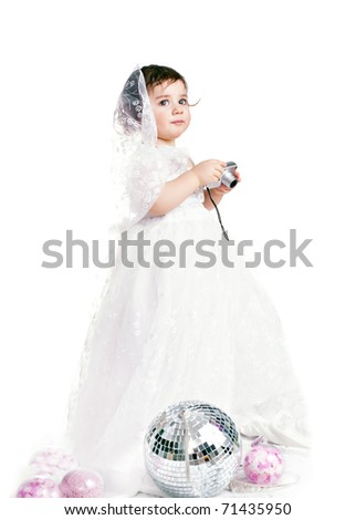 baby girl in a white wedding dress - stock photo