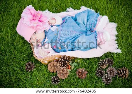 Baby girl in basket - stock photo