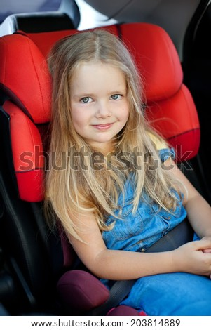 baby girl in car seat - stock photo