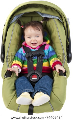 Baby girl in car seat isolated on white - stock photo