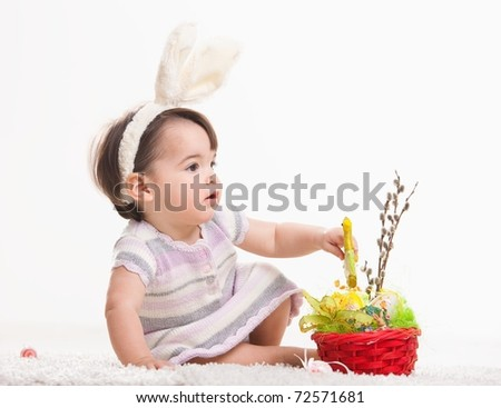 Baby girl in easter bunny costume, playing with chicken in easter basket. Isolated on white background.? - stock photo