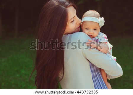 Baby girl in her mother's arms