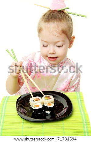 Baby girl in japanese dress with sushi