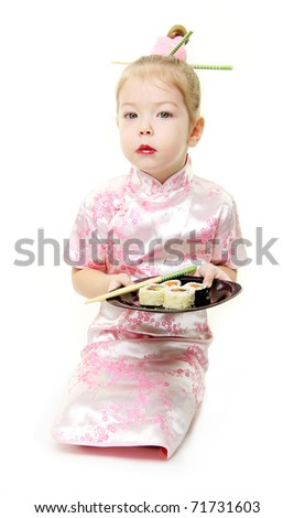 Baby girl in japanese dress with sushi - stock photo